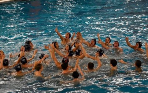 The boys water polo team celebrates their state title.
