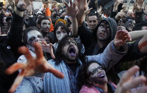 People dressed and made up as Zombies react, during the annual Zombie march, in Madrid, Saturday Feb. 27, 2010. The zombie march is a homage to the Zombie film genre and to U.S. director George A. Romero, famous for his Zombie horror movies. (AP Photo/Paul White)