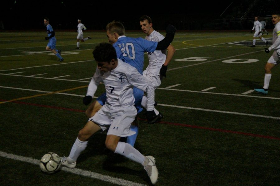 North Penn's Ryan Mindick and La Salle's James Crawford, battle for possesion of the ball near midfield.