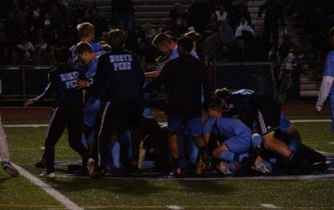 The boys soccer team celebrates their district title.