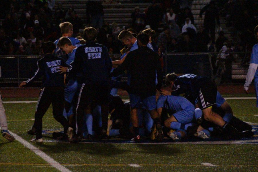The+boys+soccer+team+celebrates+their+district+title.