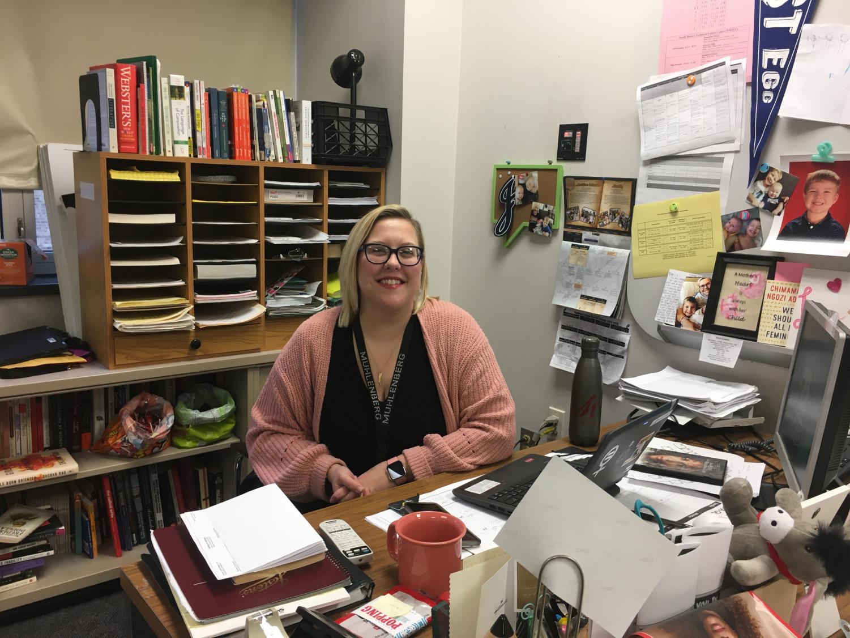 Mrs. Elizabeth Weizer posed at her desk in room K128.