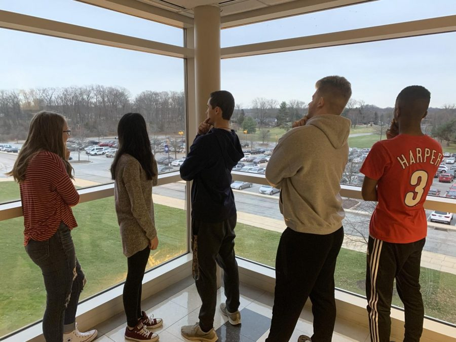 NPHS seniors ponder the future that is the 2020s. Well...actually they're staged in a pondering pose, but you get it!