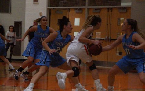 The Knights fill the lane as Alli Lindsay comes up with a steal.
