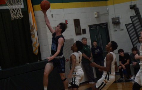Mike Chaffee scores a layup on the fast break.