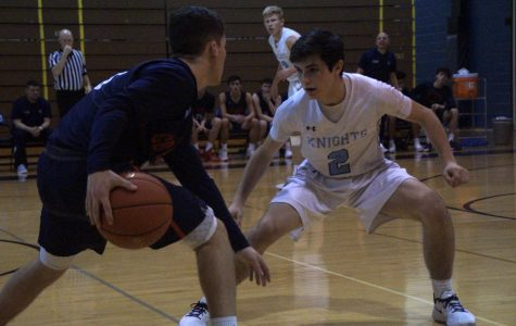 John Dolan playing defense on the perimeter for the Knights.