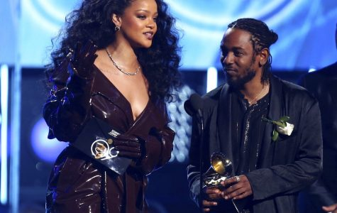 Rihanna, left, and Kendrick Lamar accept the award for best rap/sung performance for