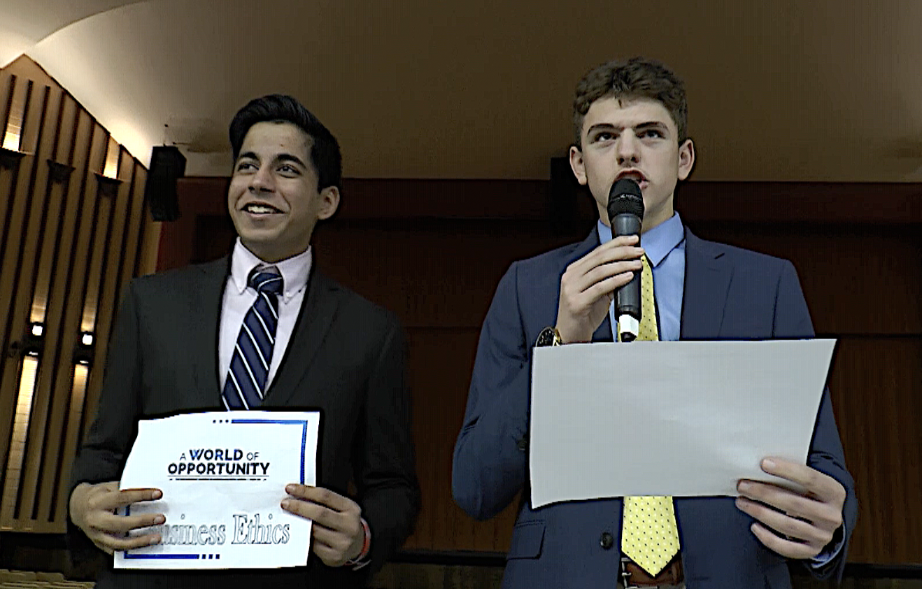 Ansh Sharma (left) and Ryan Gant (right) announce names to organize students into presentation groups. Ansh and Gant both qualified for the state championship.
