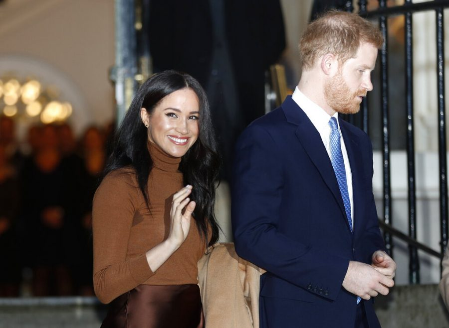 FILE - In this Jan. 7, 2020, file photo, Britains Prince Harry and Meghan, Duchess of Sussex leave after visiting Canada House in London, after their recent stay in Canada. Prince Harry and Meghan Markle are to no longer use their HRH titles and will repay £2.4 million of taxpayers money spent on renovating their Berkshire home, Buckingham Palace announced Saturday, Jan. 18. 2020. (AP Photo/Frank Augstein, File)