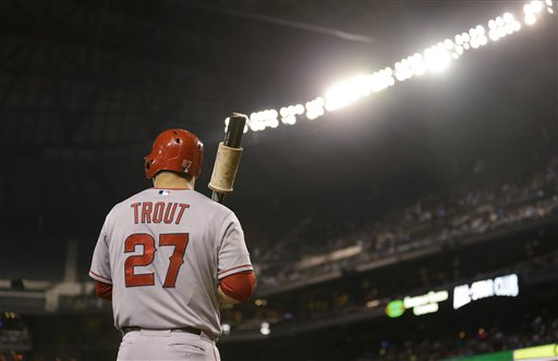 Los Angeles Angels' Mike Trout stands under the lights of Safeco Field as he waits for an at-bat duirng a baseball game against the Seattle Mariners, Friday, Sept. 26, 2014, in Seattle. (AP Photo/Ted S. Warren)