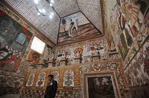 A groom waits for the bride before their wedding at the Sistine Chapel of Los Andes in Curahuara de Carangas, Oruro department, 260 km. (160 miles) south from La Paz, Bolivia, Saturday, Dec. 8, 2012.  Although a far cry from the original Sistine Chapel at the Vatican,  this small church, built in 1608 to evangelize indigenous Bolivians into the Roman Catholic faith, attracts both the faithful and tourists and it's a popular choice for special religious services. (AP Photo/Juan Karita)
