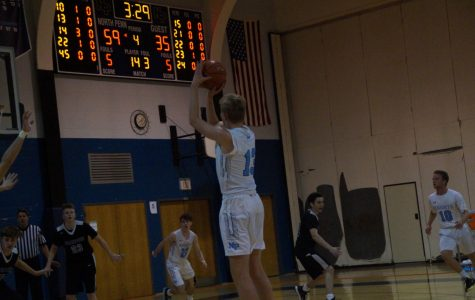 Josh Jones shoots a three ball in his 28-point performance against the Panthers.
