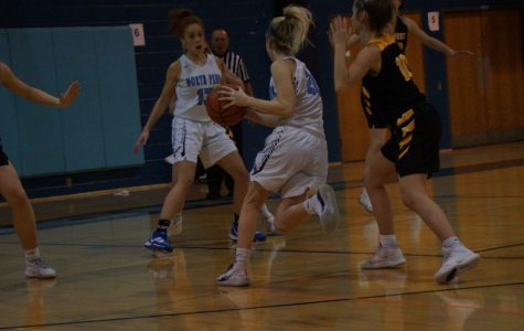Alaina Mullaly drives to the basket for a layup.