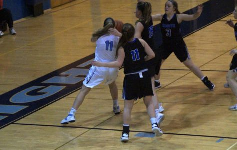 Alli Lindsay drives to the rim in the second half with several Titans nearby.