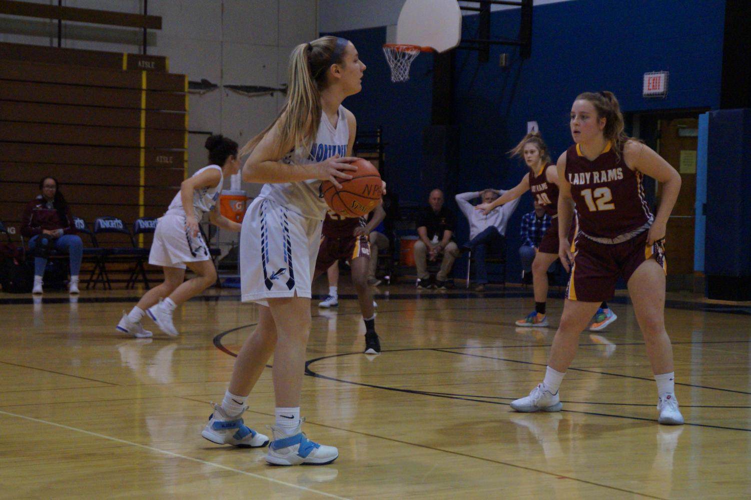 Point guard, Alli Lindsay, looking to pass the ball for the Knights