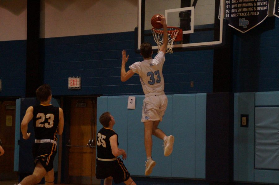 Rob Carangi goes up for his first half dunk.