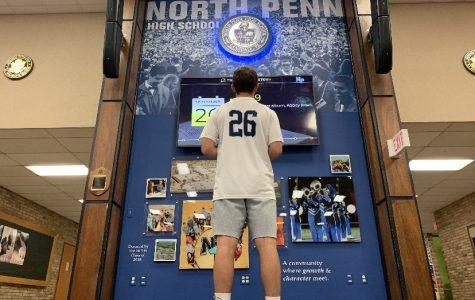 NPHS Sophomore Ben Barbosa ponders life in the NPHS auditorium lobby.