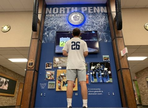 NPHS Sophomore Ben Barbosa ponders life in the NPHS auditorium lobby.
