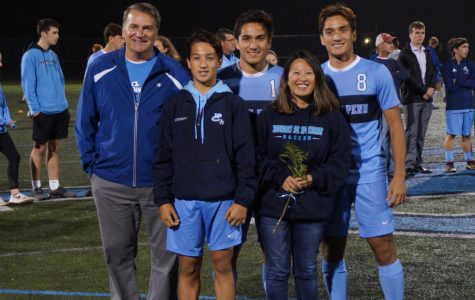 The Stewart family on senior night as Ryan Stewart (middle) and Jamie Stewart (right) have their senior ceremony, with younger brother Alex Stewart (left bottom row) walking with them.