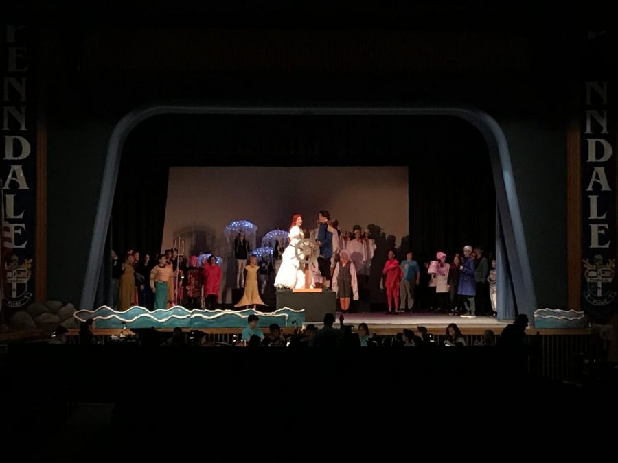 The ensemble of The Little Mermaid rehearses the finale wedding scene.