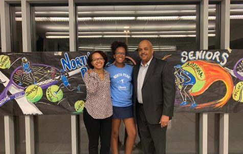 Henderson (center, with her parents) will be attending the University of Pittsburgh in the fall.