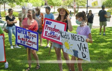 From left: Carrie Bramlette, Kelli Silva and her daughter wave their signs to protest the closure of Texas at the East Texas Freedom Coalition's protest at Tyler City Hall.