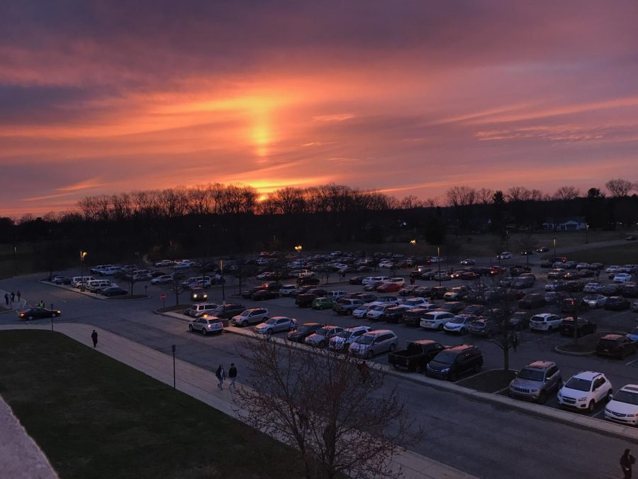 A look at an early morning sunrise from third-floor k-pod. Take a closer look, and you'll also notice a parking lot filled with cars driven by students and teachers. Although the parking lot may not get to be filled to full capacity this year, going hybrid will bring back some life into this lot.