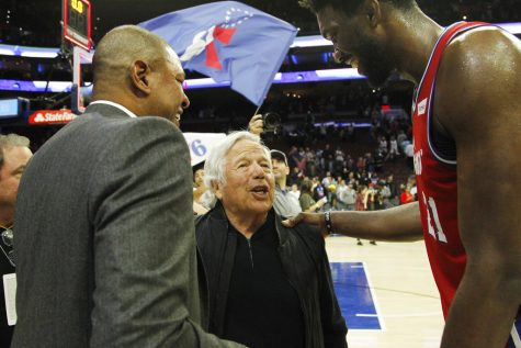 New England Patriots NFL football team CEO Robert Kraft, center, and Los Angeles Clippers coach Doc Rivers, left, talks with Philadelphia 76ers center Joel Embiid after an NBA basketball game against the Los Angeles Clippers, Thursday, Nov. 1, 2018, in Philadelphia. The 76ers won 122-113. (AP Photo/Laurence Kesterson)