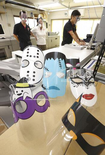 Face shields that featuring Halloween are manufactured at a printing company Handa in Niiza, Saitama Prefecture on Oct. 6, 2020. About 10 kinds of illustrations such as Frankenstein, ghost, animals are printed on face shields.