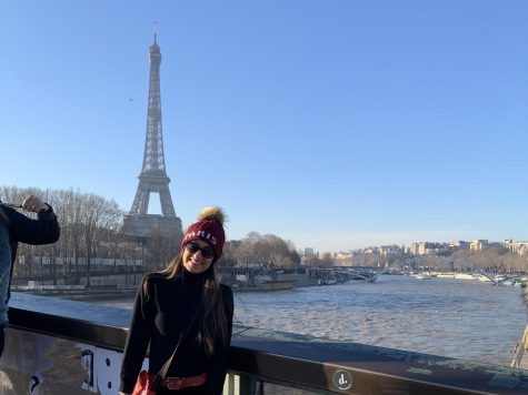 Chhugani posing for a photo in front of the Eiffel Tower when her family came to visit.