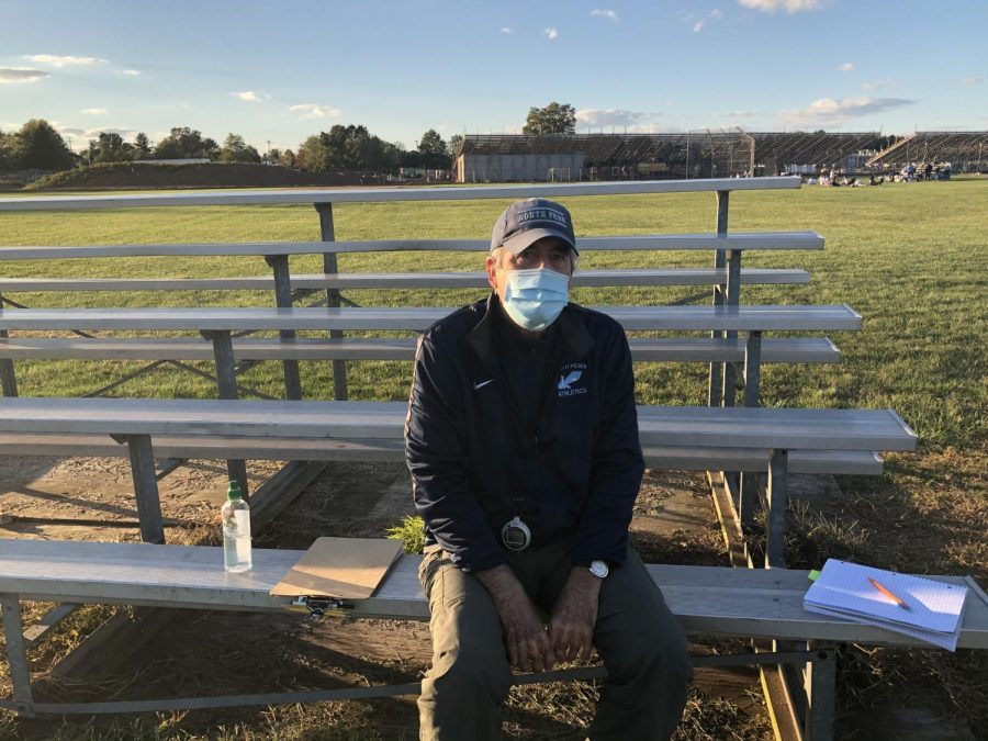 Coach Jim Crawford Jr sitting on the benches by the softball field after s Cross Country practice last week.  Jim Crawford, Jr has seen a lot in his years coaching at North Penn, and now he's coaching through a pandemic.