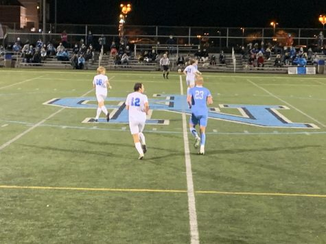 Josh Jones at midfield of the Knights quarterfinal playoff game