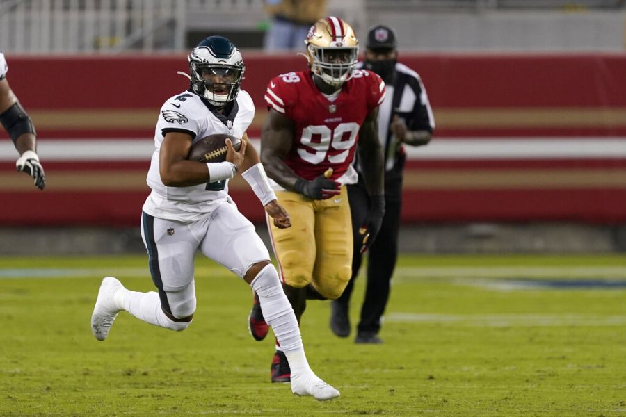Philadelphia Eagles quarterback Jalen Hurts (2) runs in front of San Francisco 49ers defensive tackle Javon Kinlaw (99) during the first half of an NFL football game in Santa Clara, Calif., Sunday, Oct. 4, 2020. (AP Photo/Tony Avelar)