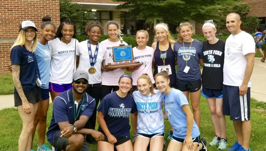 The girls gather at the Spring States meet 2019 with the many medals and trophies they have won.