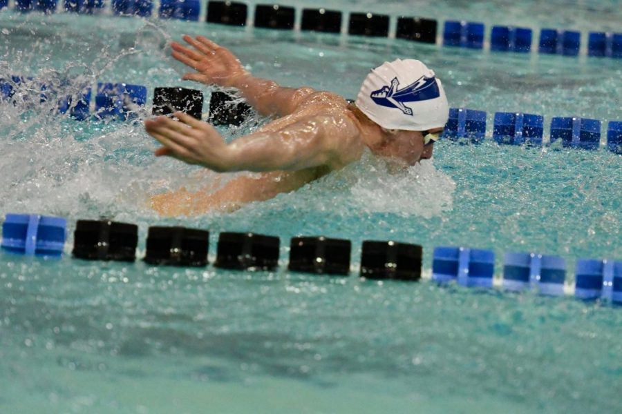 Clark competing in a Knights swim meet.