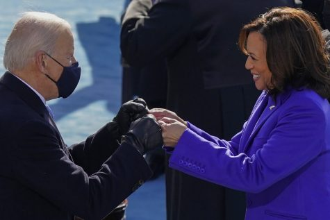 President-elect Joe Biden congratulates Vice President Kamala Harris with a fist bump after she was sworn in during the 59th Presidential Inauguration at the U.S. Capitol in Washington, Wednesday, Jan. 20, 2021. (AP Photo/Carolyn Kaster)