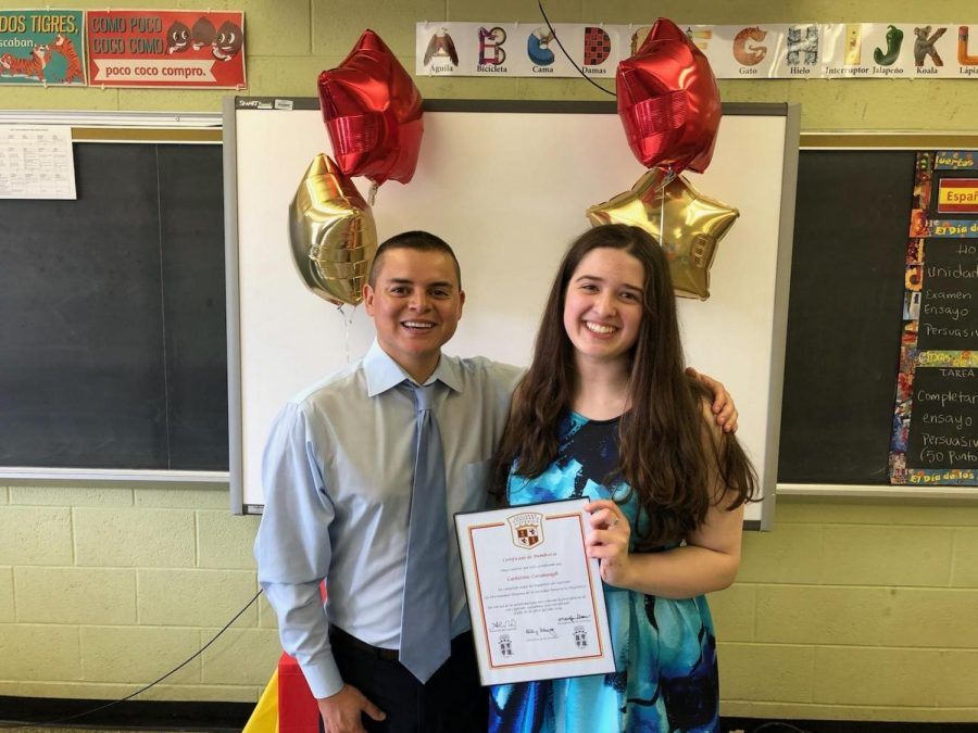 Cavanaugh and Senor Vidal at a 2019 Spanish Honor Society celebration.