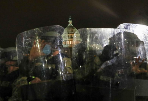 Members of the National Guard stand guard outside the Capitol Building, January 6.