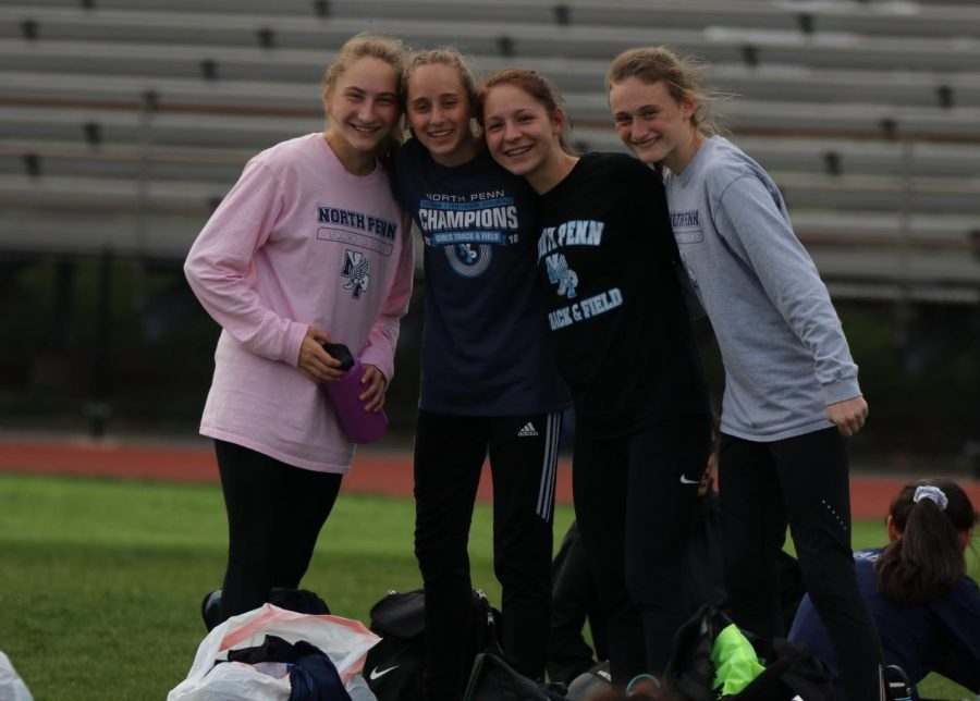 Jamie Diedel, Izzy Dahms, Jayme Corrado, and Megan Gambogi (from left to right) gather together at their annual league meet in 2019.