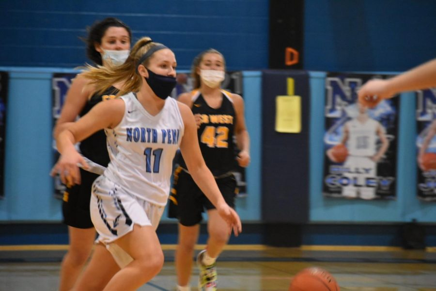 Lindsay dribbles up the court during her senior year to lead the North Penn girl's basketball team through this season of COVID.