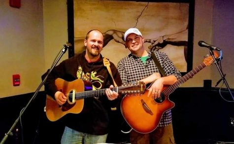 Gourley (Left) with his bandmate doing what they love together, playing the guitar.