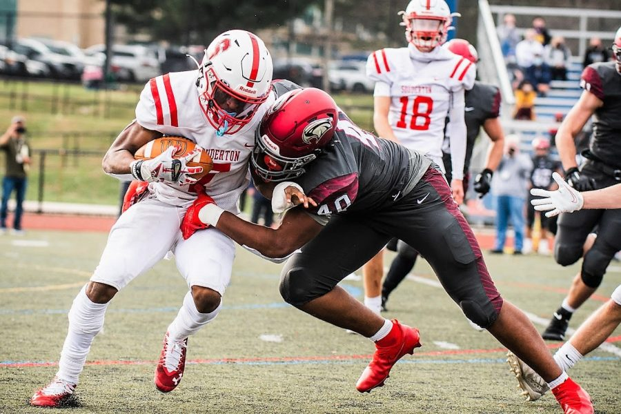 2 - Souderton's Jalen White (7) is hit in the backfield by St. Joseph Prep's Josiah Trotter (40) during their PIAA-6A semifinal at Cardinal O'Hara on Saturday, Nov. 21, 2020. (James Beaver/For MediaNews Group)