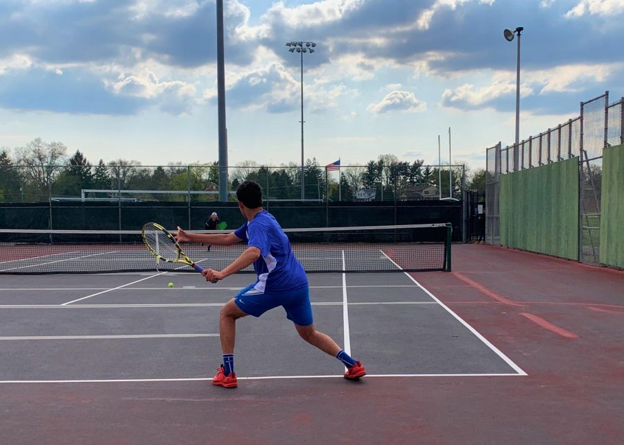 Jay Dosher (10) preparing a backhand mid-game.