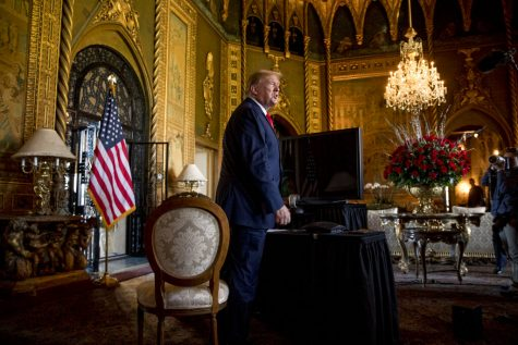 FILE - In this Dec. 24, 2019, file photo President Donald Trump speaks to members of the media following a Christmas Eve video teleconference with members of the military at his Mar-a-Lago estate in Palm Beach, Fla. Congressional Republicans are at a crossroads with Donald Trump. One branch of the party is keeping close to the former president, hoping to harness the power of his political brand for their campaigns. The other is splitting away and trying to chart a post-Trump future. (AP Photo/Andrew Harnik, File)