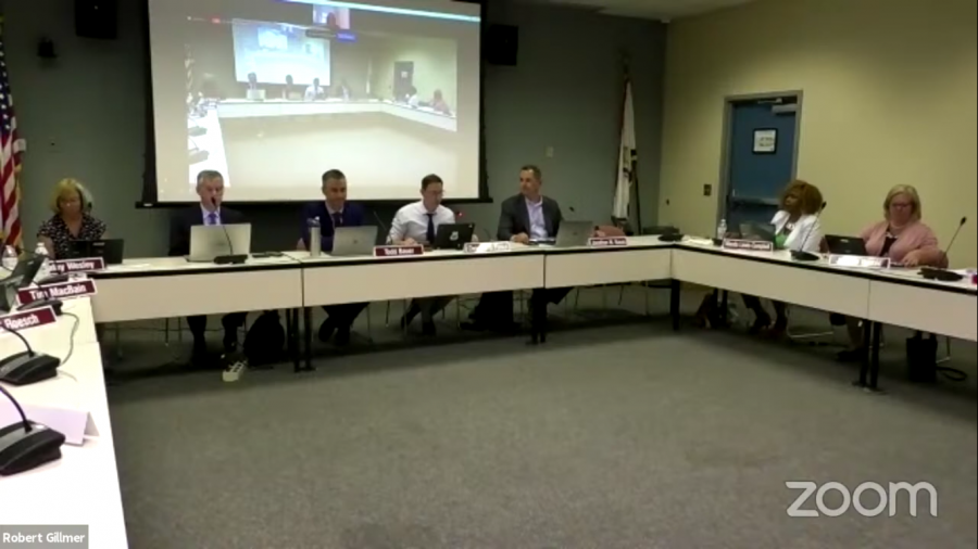 Board updates timeline for the 2021-2022 school year and discusses optional masks in schools
