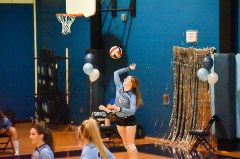Senior girls volleyball captain Charlotte Patterson hits her 1000th assist in her high school career on senior night.